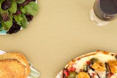 Chicken casserole, salad, sesame bread and wine Stock Photo