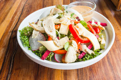 Chicken cheese salad with caesar dressing Stock Image