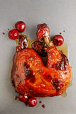 Chicken with cherries Stock Images