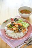 Chicken, chicken blood jelly and shrimp stir fry with rice. Thai food stock images