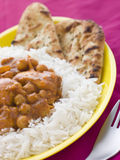Chicken and Chickpea Curry with Rice Stock Photography