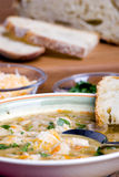 Chicken Chili. An inviting bowl of fresh chicken chili and hot bread Stock Photos