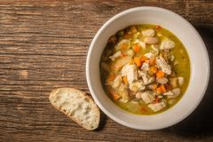 Chicken Chili Soup in a home made ceramic bowl stock photography
