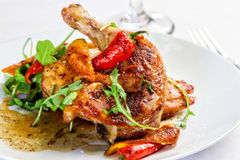 Chicken and Chilis. A plated meal of chicken with chili peppers Royalty Free Stock Photos