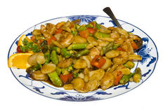 Chicken chinese dish. Picture of a sauteed chicken dish isolated over white Royalty Free Stock Photos