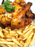Chicken and chips. A fried chicken and some chips Royalty Free Stock Photography