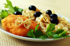 Chicken chop of kiev and pasta with olives ready Stock Images