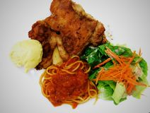 Chicken chop. With salad and spaghetti Stock Photo