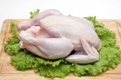 Chicken on a chopping board Stock Photo