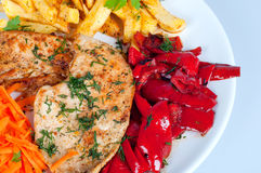 Chicken chops with french fries and vegetables Royalty Free Stock Images