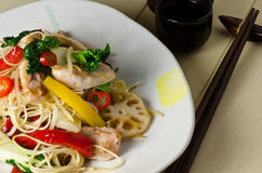 Chicken Chow Mein. A plate of stir fry chicken chow mein with lotus root royalty free stock images