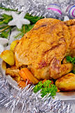 Chicken Christmas with vegetables and silver tinsel Royalty Free Stock Photography