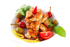 Chicken chunks served with tomatoes Stock Images