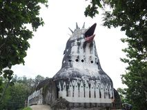 Chicken Church Gereja Ayam. Hidden deep inside the Indonesian jungle lies an enchanted `church` which looks like a giant chicken. The long-abandoned structure royalty free stock photo
