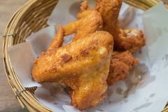 Chicken. Close up Fried Chicken in a basket on a wooden floor Royalty Free Stock Photo