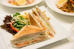 Chicken club sandwich with french fries. A Chicken club sandwich with french fries stock photos