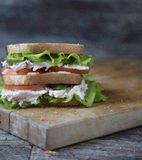 Chicken Club Sandwich with Lettuce and Tomato. On old wooden table stock photography