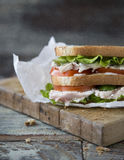 Chicken Club Sandwich with Lettuce and Tomato. On old wooden table royalty free stock photography