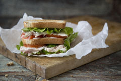 Chicken Club Sandwich with Lettuce and Tomato. On old wooden table stock photos