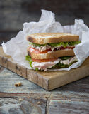 Chicken Club Sandwich with Lettuce and Tomato. On old wooden table royalty free stock images