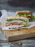 Chicken Club Sandwich with Lettuce and Tomato. On old wooden table royalty free stock photos