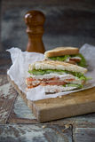 Chicken Club Sandwich with Lettuce and Tomato. On old wooden table stock photo