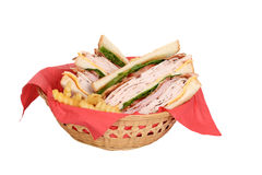 Chicken club sandwich in wood basket. Isolated chicken club sandwich in wood basket royalty free stock images