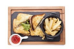 Chicken club sandwich on a wooden cutting board isolated on whit. E royalty free stock image