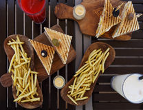 Chicken club sandwiches and french fries on the table Royalty Free Stock Images