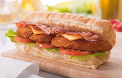 Chicken Clubhouse Sub. A delicious crispy chicken clubhouse submarine sandwich stock images
