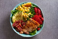 Chicken Cobb Salad. Chicken bacon avocado and sweet corn salad. View from above, top studio shot stock images