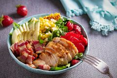 Chicken Cobb Salad. Chicken bacon avocado strawberry and sweet corn salad - healthy food. Chicken Cobb Salad. Chicken bacon avocado strawberry and sweet corn royalty free stock image