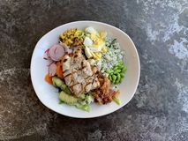Chicken Cobb Salad. With Avocado, Egg and Bacon shot on Concrete Background with room for copy stock photo