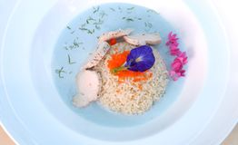 Chicken coconut milk with butterfly pea soup. Jasmine fried rice with butter and pepper. Galangal , lemon grass, Lemon leaf Royalty Free Stock Image