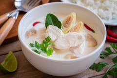 Chicken with coconut milk soup and rice, Thai food Tom Kha Kai. Chicken with coconut milk soup in bowl and rice on plate , Thai food Tom Kha Kai stock photos