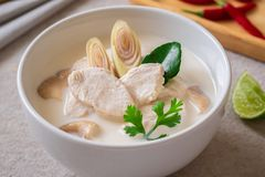 Chicken with coconut milk soup in bowl, Thai food Tom Kha Kai. Chicken with coconut milk soup in white bowl, Thai food Tom Kha Kai stock image