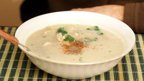 Chicken coconut soup seasoning with chili and pepper close up stock video