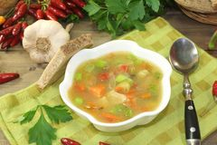 Chicken consomme with bread. Chicken consomme with greens, chilli and bread Royalty Free Stock Photography
