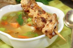 Chicken consomme skewers and greens. On a napkin Royalty Free Stock Images