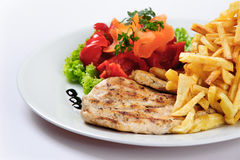 Chicken cooked breast and fried potatoes Stock Photos