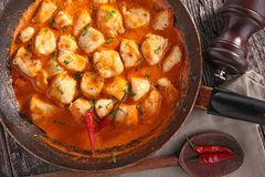 Chicken cooked with curry sauce royalty free stock images