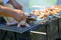 Chicken cooking on barbecue grill. Chicken cooking outdoors on barbecue grill Royalty Free Stock Photo