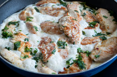 Chicken cooking in a cream sauce stock photo
