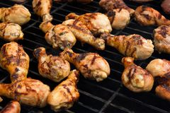 Chicken cooking on a grill Stock Photography