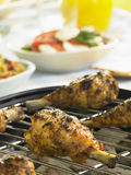 Chicken Cooking On A Grill Royalty Free Stock Image