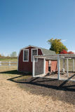 Chicken Coop. Red chicken coop on a sunny fall day Royalty Free Stock Image