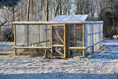 Chicken coop in winter. Exterior of agricultural chicken coop and run in winter Stock Photography