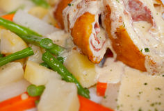Chicken Cordon Bleu with boiled potatoes and vegetables Royalty Free Stock Image
