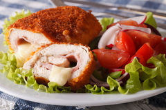 Chicken Cordon Bleu Cut And A Salad Close-up. Horizontal Royalty Free Stock Photography
