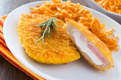 Chicken cordon bleu with grated carrots. Close up of chicken cordon bleu with grated carrots Royalty Free Stock Image